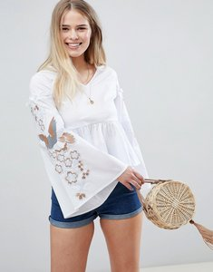 Read more about Glamorous smock top with flared sleeves and embroidery - white