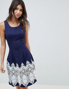 Read more about Louche dress with contrast border print - navy cream