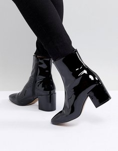 Read more about Asos design rosana leather block heeled boots - black patent