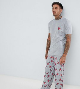 Read more about Asos design pyjama set in dinosaur print - multi