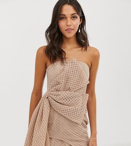 Read more about Asos design mini dress in structured broderie with hitched hem dress