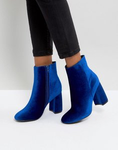 Read more about Truffle collection curved heel boot - blue velvet