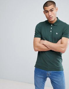 Read more about Abercrombie fitch stretch pique slim fit polo icon moose logo in green - deep forest