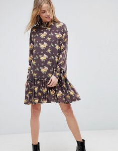 Read more about Asos washed mini dress with ruffle hem in floral print - multi
