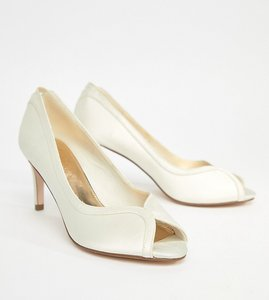 Read more about Asos summer bridal mid heels - ivory