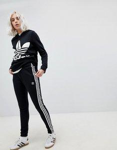 Read more about Adidas originals adicolor three stripe regular fit cuffed track pants in black - black