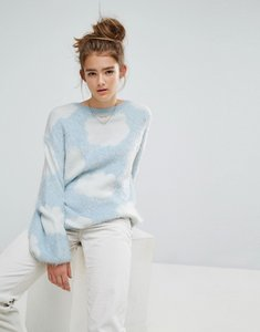 Read more about E l k relaxed jumper in fluffy cloud knit - light blue