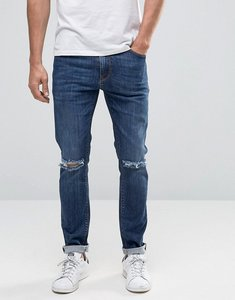 Read more about Asos skinny jeans with knee rips in dark blue wash - dark wash blue