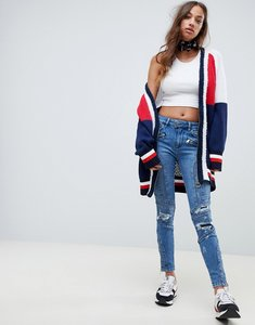 Read more about Tommy hilfiger x gigi hadid venice panelled destroyed skinny jeans
