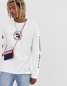 Read more about Tommy jeans summer heritage capsule long sleeve top in white with back and sleeve print
