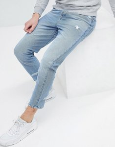 Read more about Asos skinny twisted seam jeans in light wash blue with abrasions - light wash blue