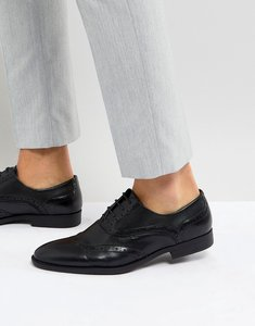 Read more about Asos brogue shoes in black faux leather with layered paneling - black