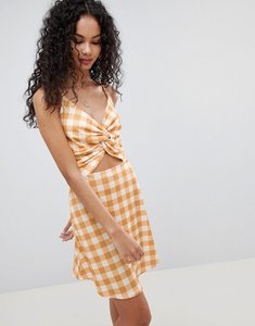 Read more about Lasula check tie front cut out dress - mustard