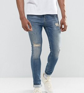 Read more about Asos tall super skinny jeans in mid blue with rip and repair - mid wash blue
