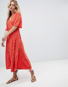 Read more about Faithfull ditsy floral wrap midi dress - blue bell print