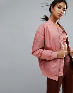 Read more about Reebok studio bomber jacket in pale pink - sandy rose