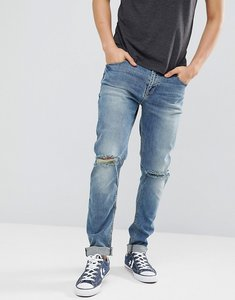 Read more about Asos design skinny jeans in mid wash with knee rips - mid wash blue