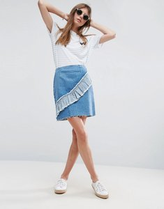 Read more about Asos denim mini skirt with asymetric ruffle in mid wash blue - blue