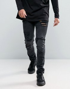 Read more about Asos design skinny jeans in 12 5oz with mega rips in washed black - washed black