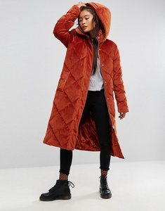 Read more about Asos longline puffer coat in quilted velvet - rust