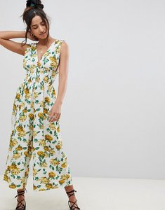 Read more about Asos design ruched waist plunge jumpsuit in floral print - multi