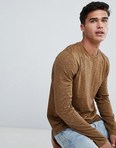 Read more about Asos design long sleeve t-shirt in twisted jersey textured fabric with curved hem in tan - tan