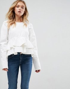 Read more about Asos denim top in white with peplum and puff sleeve - white