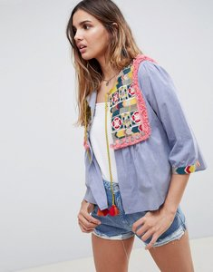 Read more about Glamorous bed jacket with embroidered panel and tassle ties in chambray - blue multi