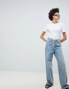 Read more about Asos design skater jeans in aged vintage wash with rope belt - vintage mid wash