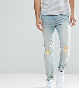 Read more about Asos tall super skinny jeans with knee abrasions in bleach blue - light wash blue