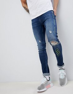 Read more about Asos design extreme super skinny jeans in dark wash blue with rips and embroidery - dark wash blue