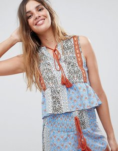 Read more about Glamorous folk top with peplum hem and tassle ties in patchwork print co-ord - blue