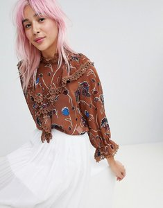 Read more about Amy lynn high neck floral printed blouse - tan