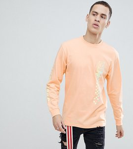 Read more about Vans oversized long sleeve t-shirt with back print in orange exclusive to asos - orange