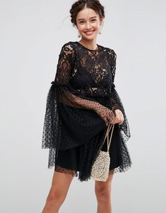 Read more about Asos lace and dobby mesh fluted sleeve mini smock dress - black