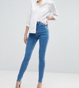 Read more about Asos design tall ridley high waist skinny jeans in light wash - lily pretty mid wash