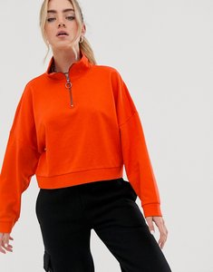 Read more about Noisy may high neck zip detail sweat in orange