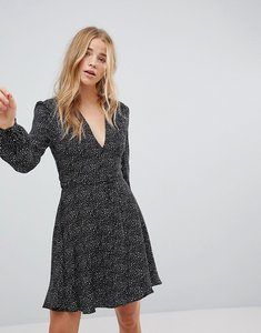 Read more about Glamorous wrap front dress in star print - black