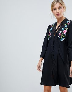 Read more about Asos design embroidered button through mini tea dress with long sleeves