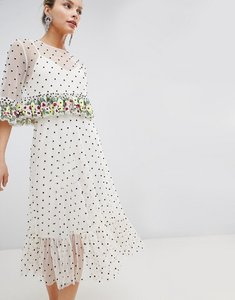 Read more about Asos design midi dress with floral ruffles and all over embellished spot - cream