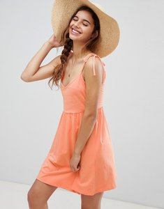 Read more about Asos design mini smock sundress with tie straps - papaya