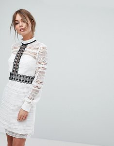 Read more about Chi chi london lace mini dress with contrast stitching and cut out back - white