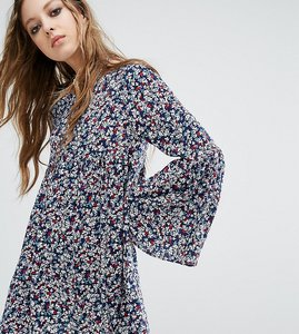 Read more about Milk it vintage smock dress in floral - blue