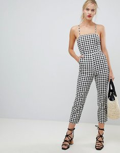 Read more about Asos design denim jumpsuit with strappy back in gingham - black white