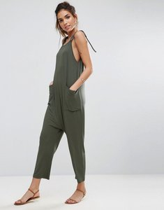 Read more about Asos design jersey minimal jumpsuit with ties - khaki