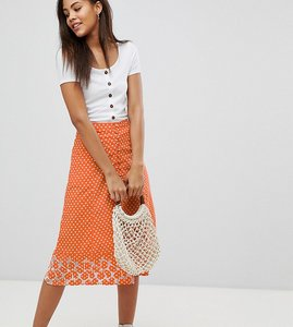 Read more about Asos design tall polka dot print midi skirt with embroidered hem - orange white