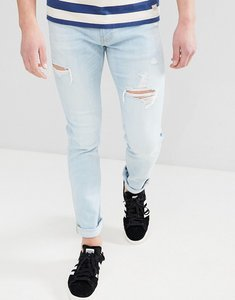 Read more about Hollister skinny distressed ripped jeans in light wash - mid wash
