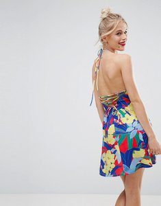 Read more about Asos mini smock sundress with lace up back in floral print - floral print
