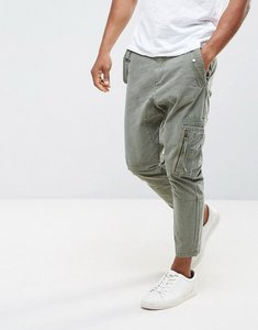 Read more about Asos drop crotch cargo trousers with strapping details in khaki - khaki