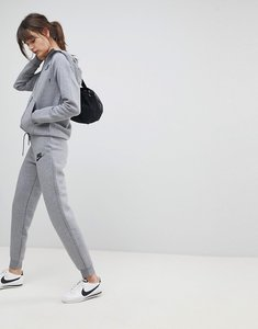 Read more about Nike rally slim fit sweatpants in grey - carbon heather cool